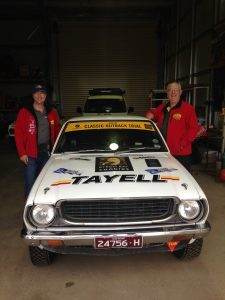 My husband and codriver with the rally car