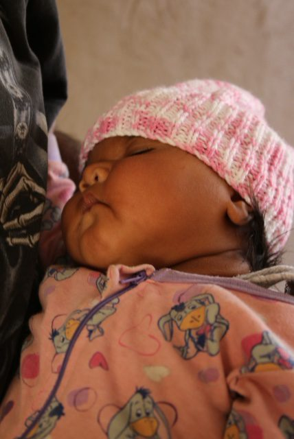 Baby wearing Beanie donated by KOGO